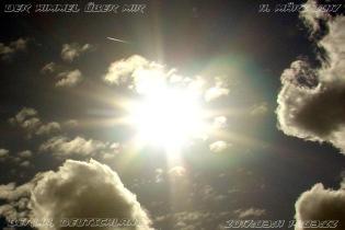 Sonne mit Strichschnuppe